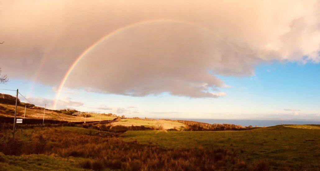 Regenboog op Isle of Arran Schotland